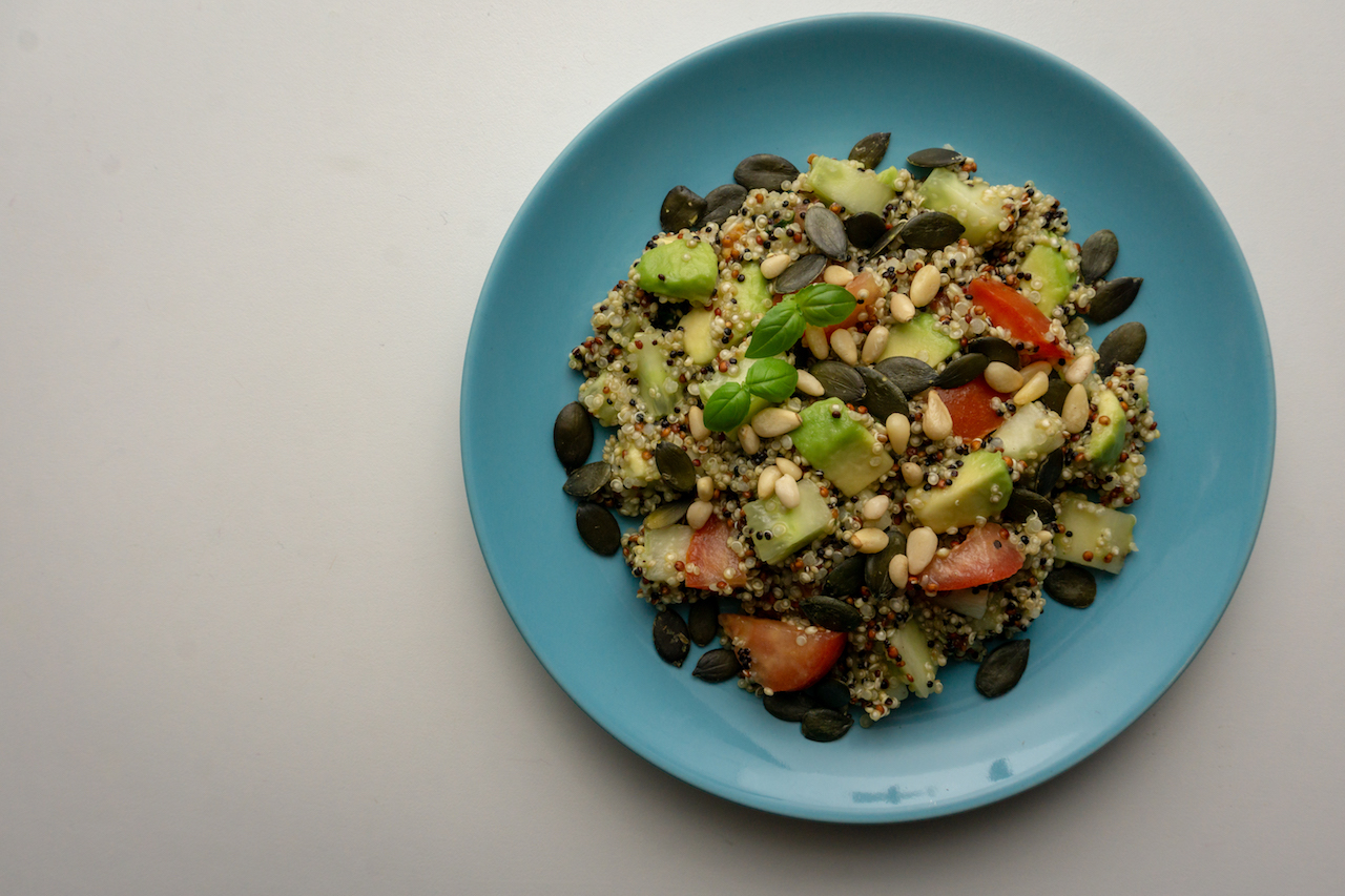 Summer quinoa salad with nuts and seeds